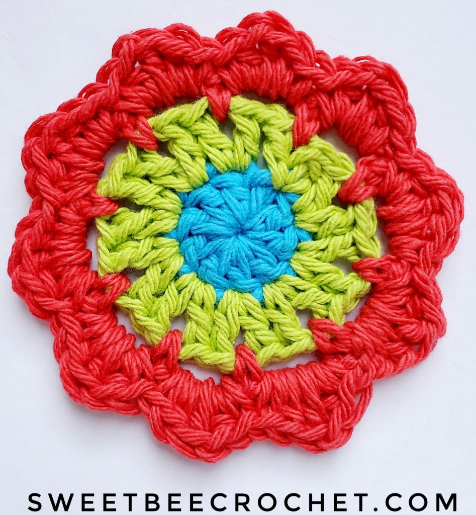 Crochet Coaster flower with 4 rounds.